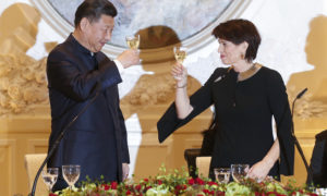 Swiss Federal President, Doris Leuthard, right, and China's President Xi Jinping raise their glasses for a toast at a gala dinner in Bern, Switzerland, Sunday, Jan. 15, 2017. Xi on Sunday kicked off a four-day visit to Switzerland, the first this century by a Chinese leader. It includes planned stops in Geneva, Lausanne and to the World Economic Forum in Davos. (Peter Klaunzer/Pool Photo via AP)