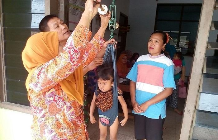 Kegiatan Posyandu di Balai Desa Waung Kecamatan Baron, Nganjuk, Jatim, Jumat (26/1/2018). Foto: Dok. Istimewa/NusantaraNews