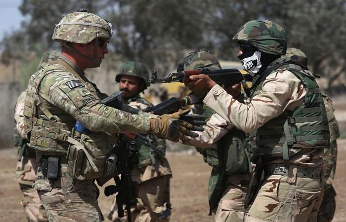 Militer Amerika Serikat melatih pasukan keamanan Irak di markas AS di Taji, 12 April 2015. (Foto: John Moore/Getty Images)
