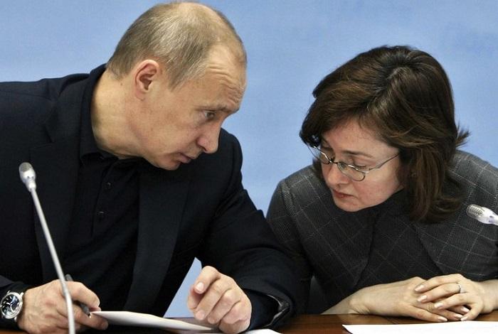 Vladimir Putin dan Gubernur Bank Sentral Rusia, Elvira Naubilina. (FOTO: Business Insider)