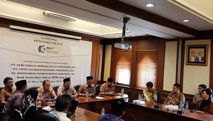 Peluncuran Dompet Rezekiku sebagai produk teknologi yang dimiliki oleh Koperasi Mabadiku Bintang Sembilan besutan komunitas Nahdliyin di bawah naungan Nahdlatul Ulama di gedung PBNU, Kramat Raya, Jakarta, Rabu (21/3/2018). (FOTO: NUSANTARANEWS.CO/Khozin)