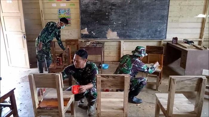 Keberadaan salah satu sekolah yang berada di Jalan Kombip, Distrik Ninatie, Kabupaten Boven Digoel, Papua, selama ini dinilai sangat membantu akan pertumbuhan pendidikan di daerah perbatasan Indonesia-Papua Nugini tersebut. (FOTO: NUSANTARANEWS.CO/Sidik Wiyono)