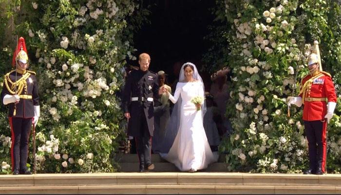 Pangerah Harry dan Menghan usai melakungsungkan prosesi pernikahan. (FOTO: NUSANTARANEWS.CO/By @markle_s)