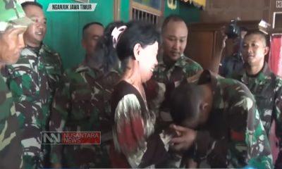 Perpisahan warga dengan TNI dalam program TMMD ke-101 di desa Lengkong Lor, Nganjuk (Foto Kredit Nusantaranews.co)