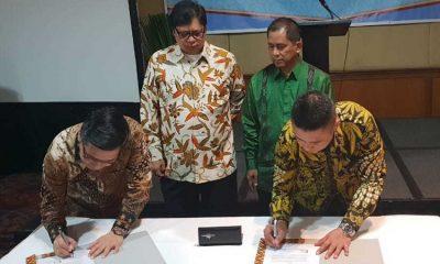 Ketua HKI Sanny Iskandar dan Direktur Enterprise & Business Service Telkom Dian Rachmawan tandatangani Nota Kesepahaman (Foto Dok. Nusantaranews)
