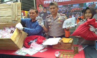 Polres Pelabuhan Perak Surabaya Tangkap Pengedar Upal 300 Dollar Senilai 100 Juta. (FOTO: NUSANTARANEWS.CO/Setya)