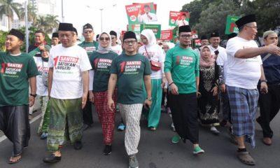 Cak Imin - Hanif Dhakiri Jalan Sehat Sarungan di Monas. (FOTO: Dok. @cakimiNOW)