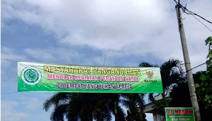 Spanduk Larangan Perayaan Natal Mencatut Nama Baznas (Foto NUSANTARANEWS.CO)