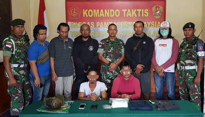 2 penyelundup Sabu seberat 1 Kg asal Filipina yang berhasil diamankan Satgas Pamtas RI-Malaysia Yonif Raider 613/Raja Alam dan Ditreskoba Polda Kaltara diperlihatkan kepada awak Media, Jumat (11/1/2019). (FOTO: NUSANTARANEWS.CO/Eddy Santry)