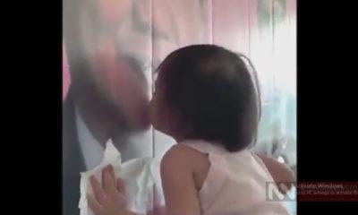 Aksi Anak Kecil Kecup Foto Prabowo (Foto Crop NUSANTARANEWS.CO)