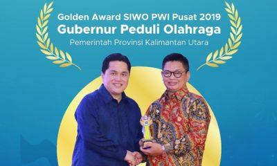 Gubernur Kaltara Irianto Lambrie menerima Golden Award SIWO PWI Pusat 2019. (FOTO: NUSANTARANEWS.CO/Humas Pemprov Kaltara)
