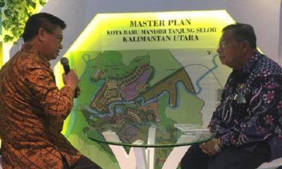 Gubernur Kaltara Dr H Irianto Lambrie menyerahkan dokumen kesepakatan pelaksana Renaksi Inpres No. 9/2018 kepada Menko Ekonomi Darmin Nasution. (FOTO: CNBC)