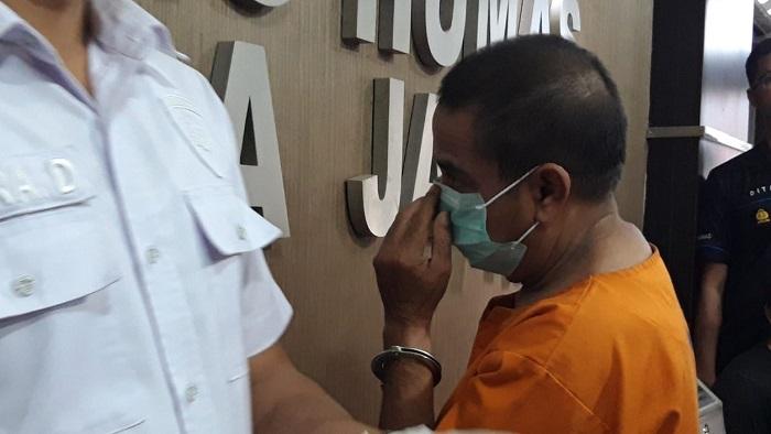 Polda Jatim Tahan Mantan Ketua PSSI karena kasus korupsi. (FOTO: NUSANTARANEWS.CO/Setya)