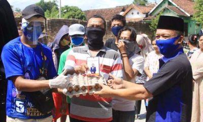 Banyak warga terdampak pandemi, Anggota DPR RI Sri Wahyuni bagikan telur ayam.