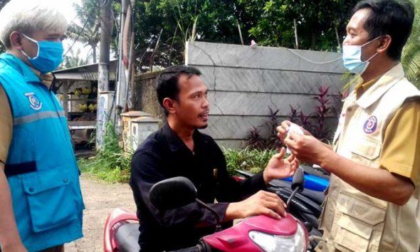 Tiga pilar kelurahan Pondok Cabe Udik bergerak razia masker.